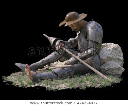 Sitting Don Quixote Figure On Isolate Black Backgroung Stok fotoğraf © denisgo