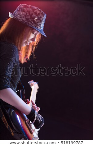 showgirl intensely playing her guitar live Stock photo © Giulio_Fornasar