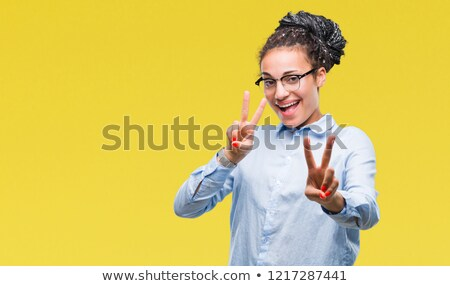 african woman showing peace stock photo © deandrobot