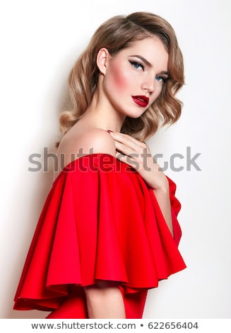 Smiling elegant young woman with red lips standing Stock photo © deandrobot