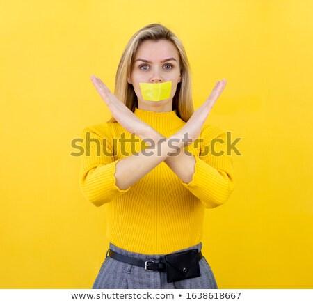 Woman's mouth sealed with a warning tape Stock photo © konradbak