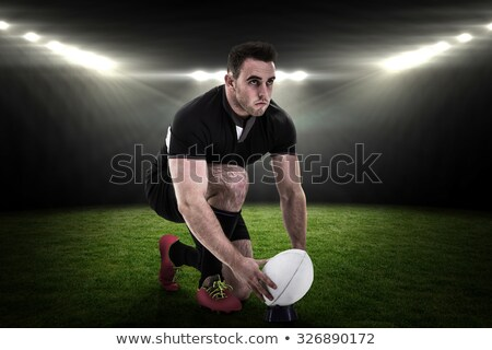 Side view of rugby player getting ready to kick for goal Stock photo © wavebreak_media