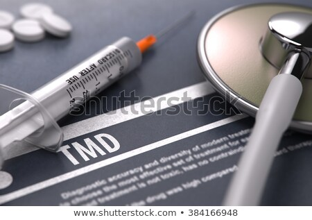 TMD - Printed Diagnosis on Grey Background. Stock photo © tashatuvango