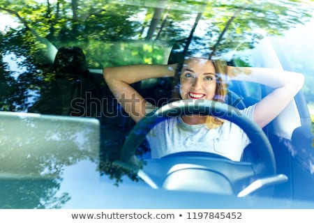 Young woman driving electric car Stock photo © IS2