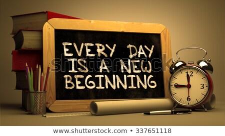 every day is a new chance handwritten on chalkboard stock photo © tashatuvango