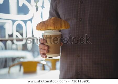 üzletember tart eldobható kávéscsésze croissant étterem Stock fotó © wavebreak_media
