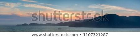 statek · wycieczkowy · horyzoncie · wygaśnięcia · mętny · burzliwy · wieczór - zdjęcia stock © yhelfman