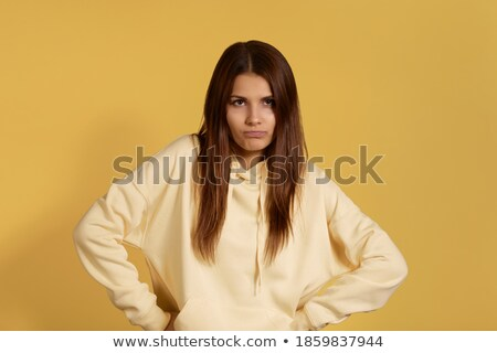 Teenage girl with hands on hips frowning Stock photo © monkey_business