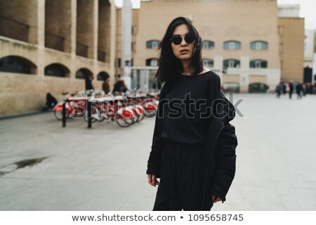 young brunette in black clothes stock photo © acidgrey