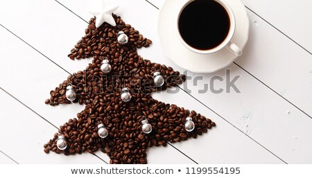 Coffee beans in shape of conifer and cup Stock photo © dash