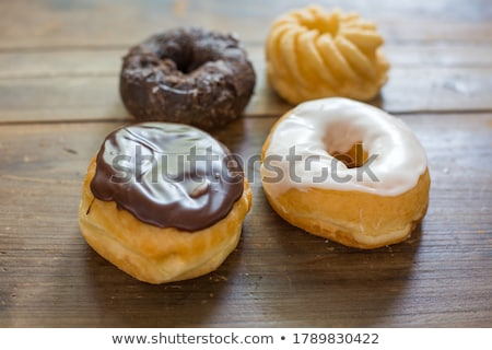 Delicious glazed donuts in box on yellow surface Stock photo © artsvitlyna