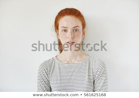 Töprengő nő vörös haj pózol fekete divatos Stock fotó © acidgrey
