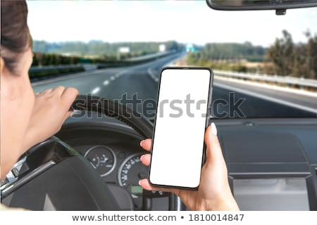 Woman using smart phone with blank black screen at outdoor Stock photo © boggy