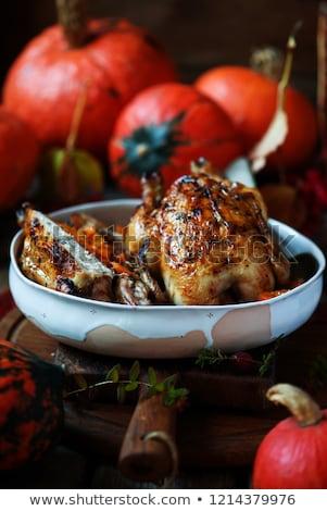 Stuffed cornish hens with pumpkin Stock photo © zoryanchik