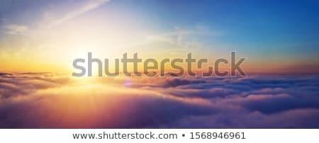 sunset with sun and clouds stock photo © vapi