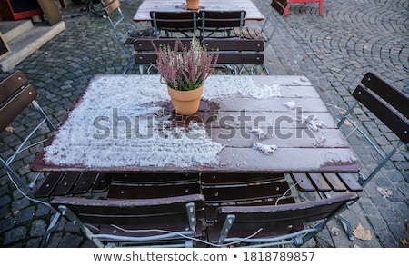 Restaurant tables and chairs under snow in winter Stock photo © simazoran