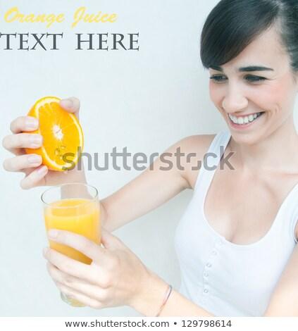 happy woman squeezing fruit juice or lemon fresh Stock photo © dolgachov