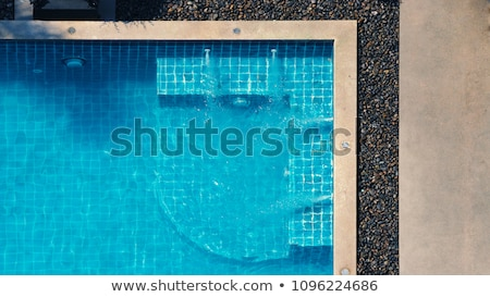 enjoying suntan vacation concept top view of slim young woman in bikini on the blue air mattress i stock photo © galitskaya
