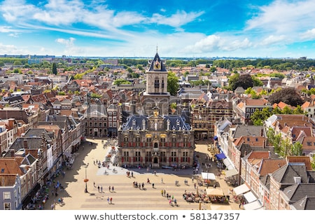 Oude binnenstad holland kleurrijk straat tulpen bloemen Stockfoto © neirfy