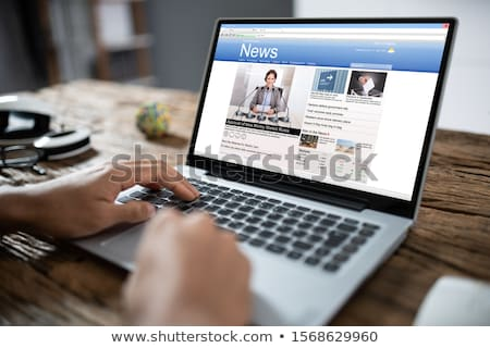 businessman checking online news on laptop stock photo © andreypopov