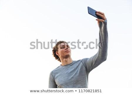 Lockig Sportler Smartphone Strand Stock foto © deandrobot