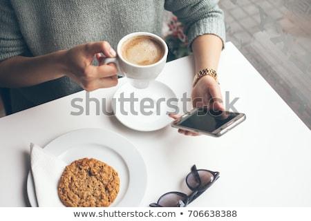 Ontspannen gadget jonge denim vergadering stoel Stockfoto © pressmaster