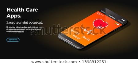 Modern Black Smart Phone Lies On A Smooth Dark Brown Surface Foto stock © Tashatuvango