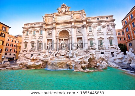 Majestic Trevi fountain in Rome street view stock photo © xbrchx
