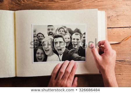 View Coppia guardando photo album seduta Foto d'archivio © AndreyPopov