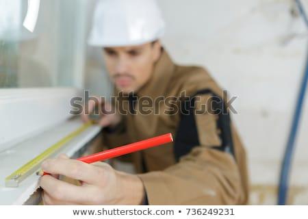 építkezés szerszám mérőszalag férfi kéz fehér Stock fotó © OleksandrO