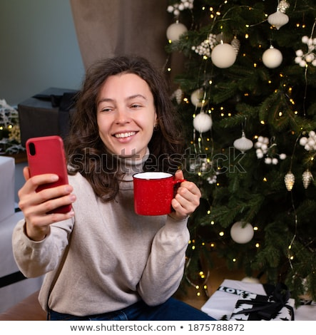 happy friends with smartphone at tea party at home Stock photo © dolgachov