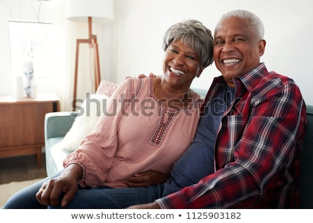 Front view of happy African American couple head to head on floor with lots of cartons  at home Stock photo © wavebreak_media