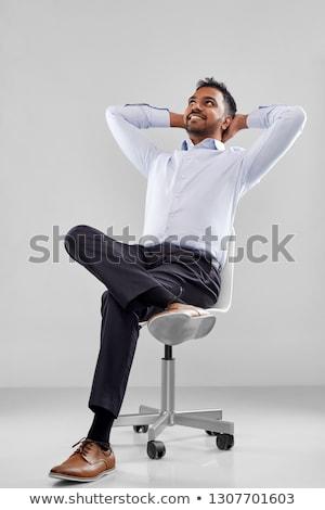 Gülen Hint işadamı oturma ofis koltuğu iş Stok fotoğraf © dolgachov