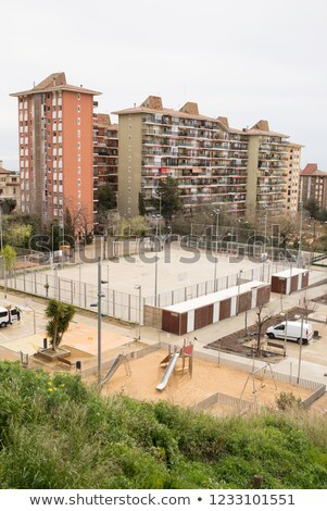 Residential Area in Barcelona with a Playground. Cloudy Day. Stock photo © ShustrikS