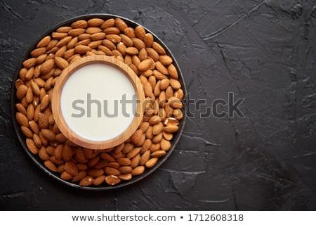 Amandelen zaden melk zwarte steen exemplaar ruimte Stockfoto © dash