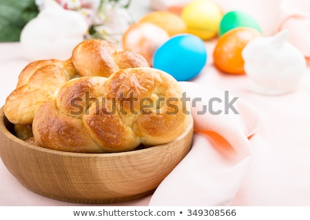 Easter bread and colorful eggs on white background Stock photo © Melnyk
