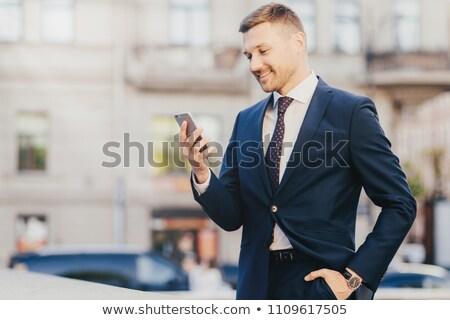 Jómódú jóképű üzletember hivatalos öltöny kéz Stock fotó © vkstudio