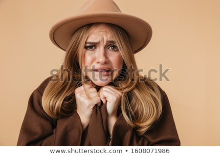 Image of young girl wearing hat and coat trembling and feeling c Stock photo © deandrobot