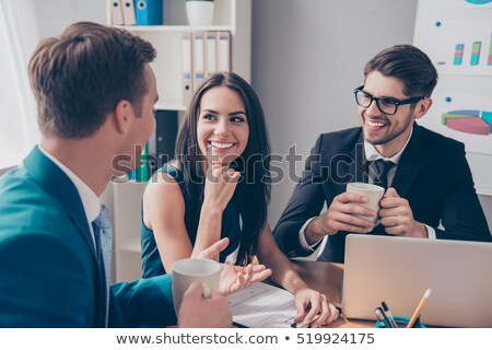 Young businessman employee drinking in the office at desk Stock photo © Elnur