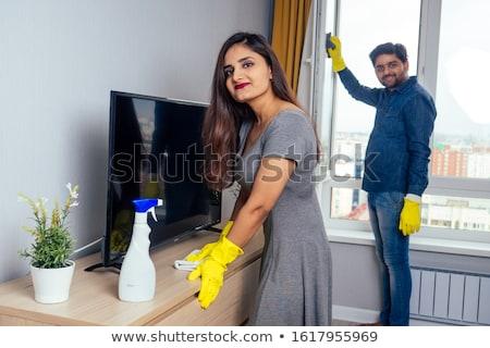 Feliz indiano homem em movimento sofá casa Foto stock © dolgachov
