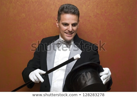 Old Magician is showing magic trick Stock photo © ra2studio