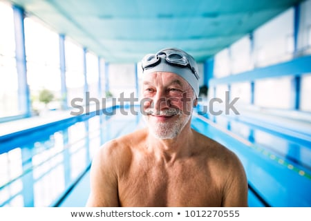 Senior retired man swimming in pool Stock photo © backyardproductions