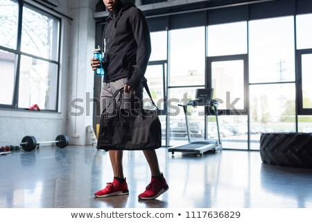 Man with bag in gym stock photo © photography33