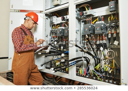 Electrician checking a distribution board Stock photo © photography33