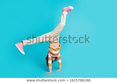 Lány akrobata diák nem tanár konzerv Stock fotó © OleksandrO