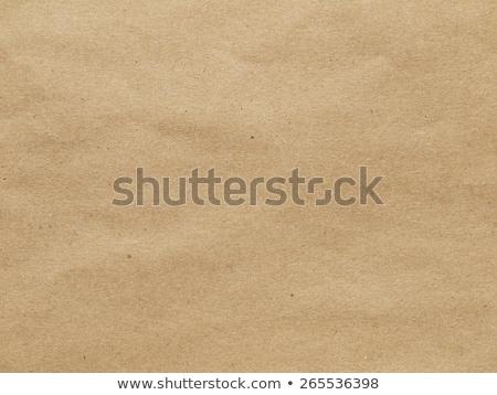 Crumpled old brown paper bag texture.