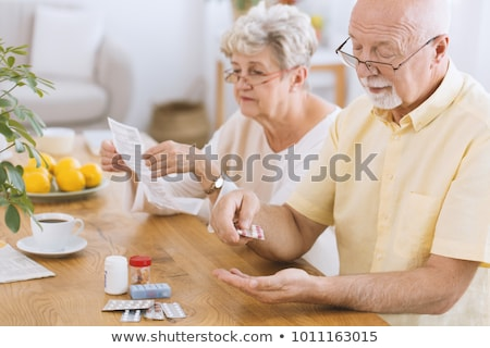 Elderly man taking his medication Stock photo © photography33
