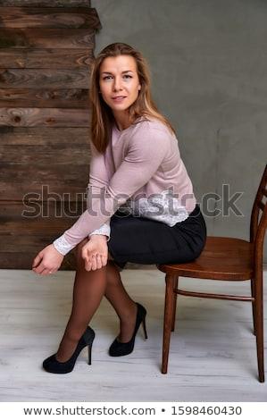 happy blonde in furry skirt Stock photo © dolgachov