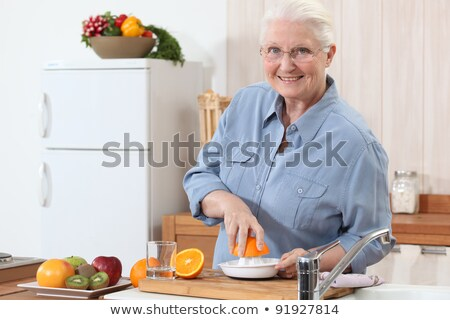 Oude dame sinaasappelen home oranje tabel Stockfoto © photography33