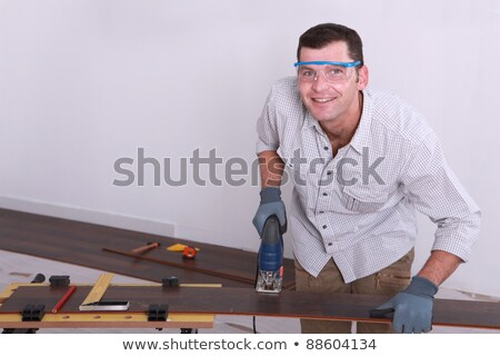 Man cutting tongue and groove floorboards with a jigsaw Stock photo © photography33